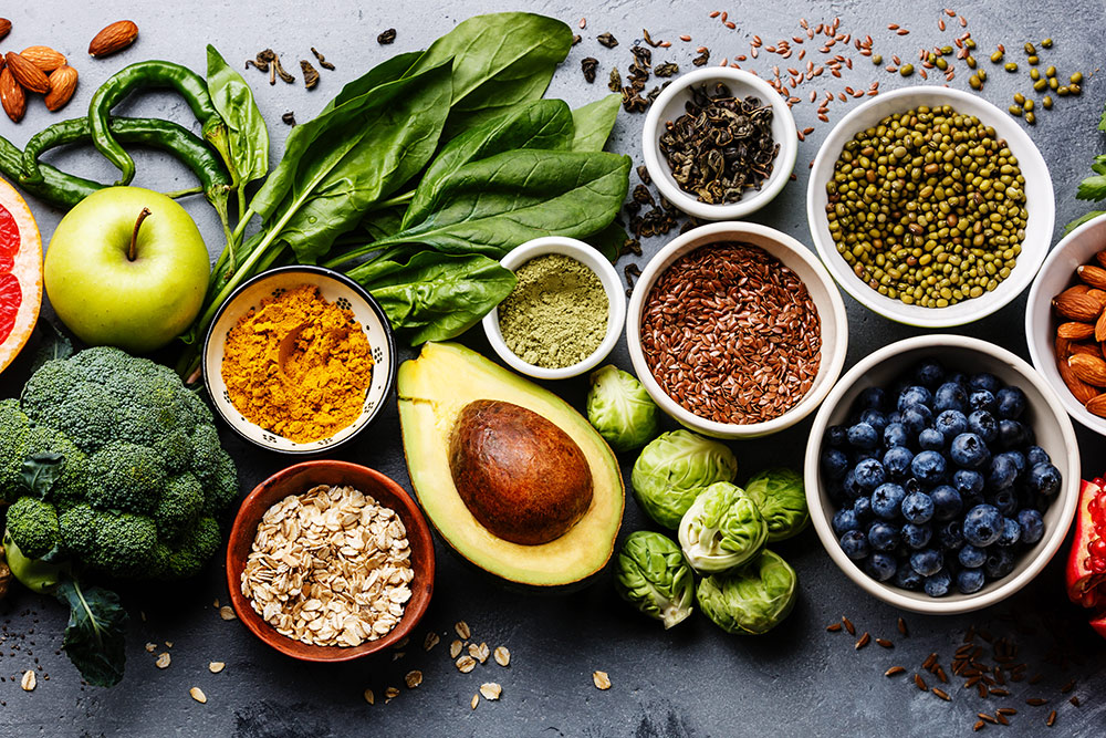 Healthy food spread out, fruits, veggies, and grains