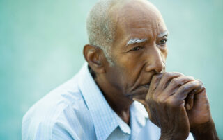 Upset and stressed senior man with dementia in memory care facility