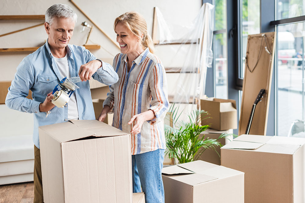 Senior couple packing as they prepare to move